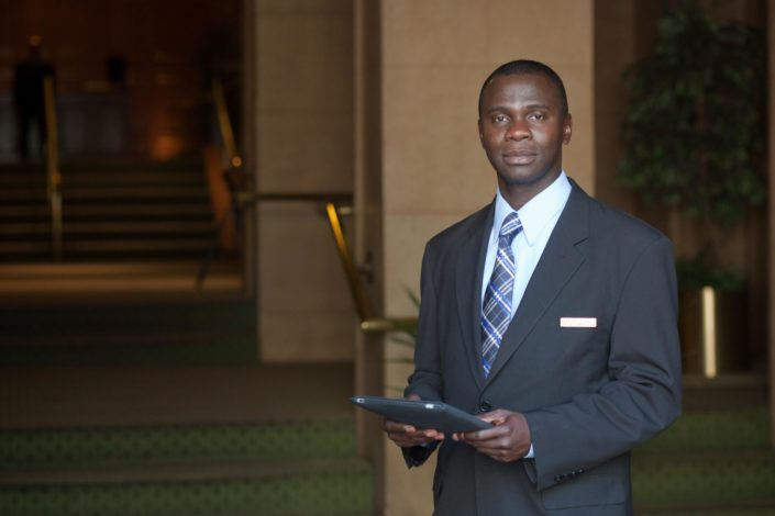 GSI concierge holding tablet